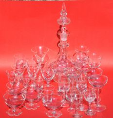 Charming collection of a decanter with 27 glasses