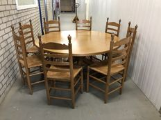 Large dining table with eight dining chairs