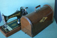 Singer 66 k hand-sewing machine with wooden case, 1929