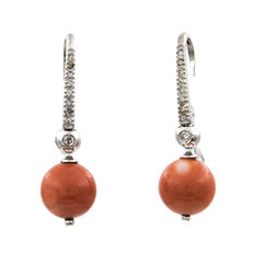 White gold earrings with brilliant cut diamonds and natural Pacific coral.