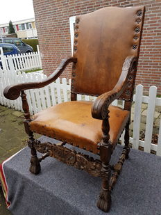 Antique leather chair with wooden frame, ca. 1900
