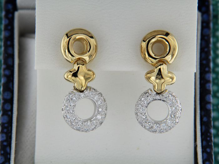 Earrings in 2 golds, yellow and white, and 0.45 ct of diamonds.