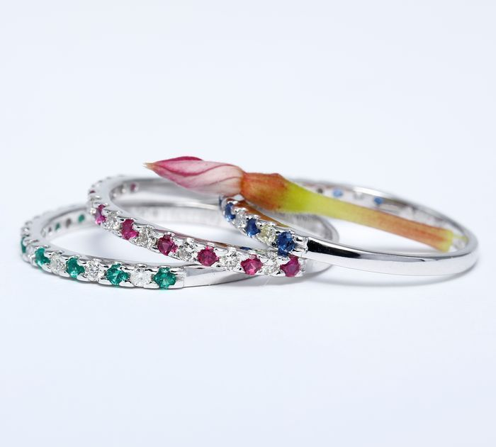 14k White Gold set of 3 diamond, ruby, blue sapphire and emerald band rings;  size 55
