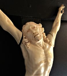 Christ in carved ivory - mounted on a blackened wooden cross - France - XIX ° century