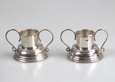 2 Silver candle stands in case 20th century