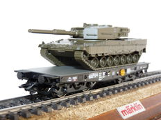 Trix H0 - 24211.01 - 4MFOR, heavy load wagon loaded with Panzer Leo2