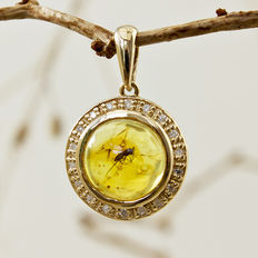 Genuine Baltic Amber pendant with included fossil insect in gold, set with diamonds, made by Nickolas Jewellery