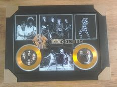 Queen framed gold effect cd display , complete with signed ( printed ) pictures.