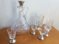 A carafe with 5 different glasses, all crystal with silver by CBZ Holland in Amsterdam