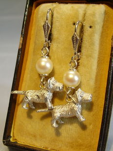 Earrings with authentic white Akoya pearls and silvery animal figures