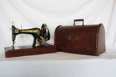 Singer Vibrating Shuttle No. 3 class 28 hand sewing machine with accessories, 1909