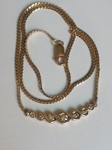Gold necklace with 0.47 ct in brilliant cut diamond