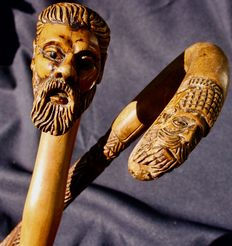 2 canes entirely carved in wood, carved knob in 2 parts for one of the 2 canes - circa 1900