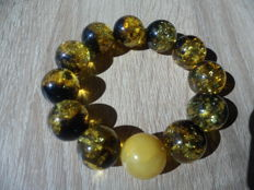 "Bracelet of  Baltic amber ""green tea"" colour, weight: 42,5 gram."