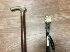 Two wooden walking sticks, early/mid 1900s