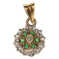 Yellow gold rosette pendant set with spinel and 7 brilliant cut diamonds of approx. 0.07 ct in total