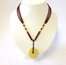 Necklace of natural Baltic Amber beads and large doughnut pendant, total weight 20.3 grams