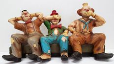 Large sculpture of three clowns - three wise monkeys