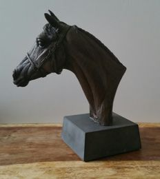 A cast bronze resin model of the racehorse Arkel bearing the artist name on the back.