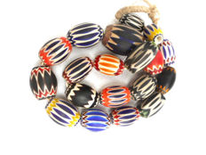 Necklace of beads in chevrons - different eras.