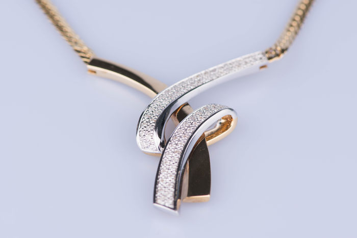 Necklace made of 18 kt yellow and white gold, 70 diamonds of 0.70 ct