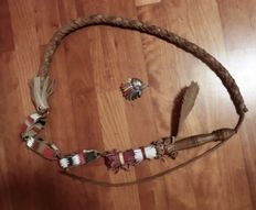 Leather whip and metal, Indian' head from 1980 with headdress