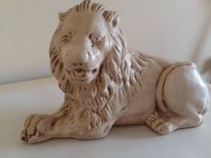 Statue of a lying lion, France, second half of the 20th century.