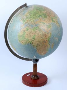 Large earth globe on wooden stand