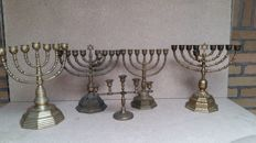 Collection of four copper/brass Hanukkah Menorahs candlesticks, second half 20th century,