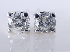 14 kt white gold solitaire ear studs, set with two brilliant cut diamonds, 0.50 ct in total ***no reserve price***