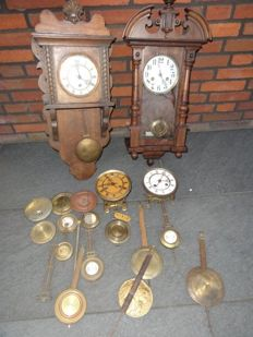 Wall clock by FHS movement, Junghans movement, period 1900, two separate timepieces and pendulums and pendulum weights.