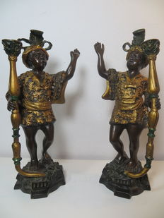 Original hand-painted blackamoor candle holders of gold-plated bronze