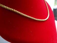 Gold women's necklace