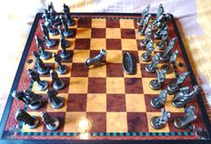 Chess and draughts of metal of the art of bullfighting. Collection