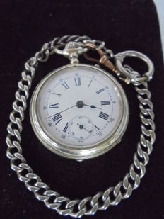 Old men's pocket watch with a heavy watch chain from the 1890s-1910s