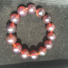 Myanmar Amber bracelet weight 28.3 grams.