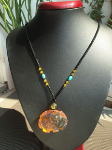Myanmar amber necklace, weighs 15.8 grams.