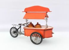 An ice cream cart with a secret compartment