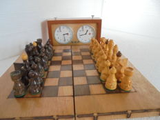 Chess board with handmade figures and a chess clock from Ruhla and a wooden box around 1950-1980