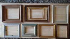 Eight brocante (gold-plated) wooden frames