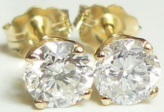 Yellow gold solitaire diamond earrings - total 0.80ct **no reserve price**