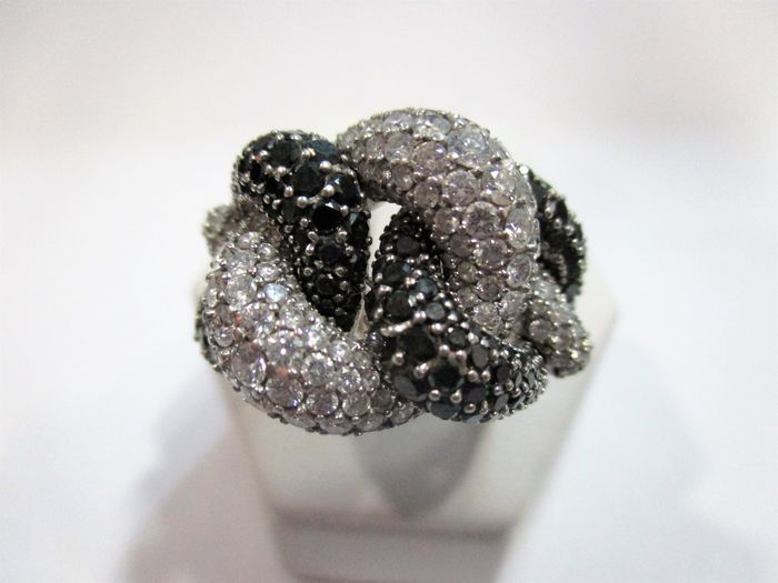 Gold cocktail ring with black and white diamonds