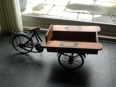 Large freight bicycle with flowers
