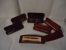 9 pens-2 letter openers in 6 cases with silver