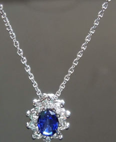 Cocktail pendant with sapphire (0.88 ct), and diamonds (F, VS) totalling 0.50 ct.