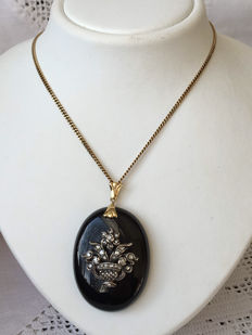 Onyx pendant, with flower basket  full of rose diamonds, on a 14 kt necklace.