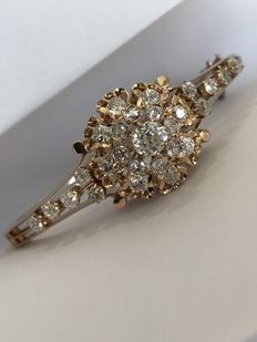 Extremely bright antique golden bracelet with diamonds