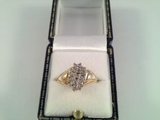 Ring is 9 kt yellow and white gold with diamonds of 0.38 ct, ring size: 17/53