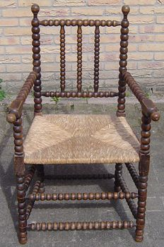 Old chair with reed seat, early 20th century