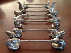 Seven silvered knife rests of different animals, the Netherlands, circa 1900